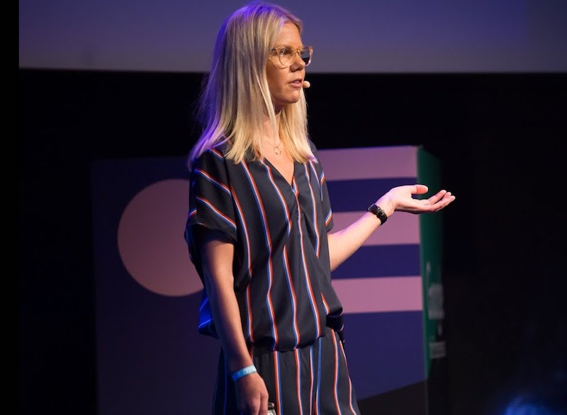 A buffer employee speaking at a conference
